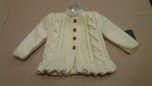 Handknitted baby jacket